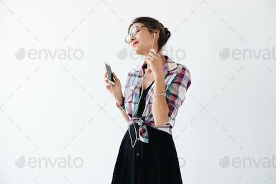 Pretty girl enjoying music