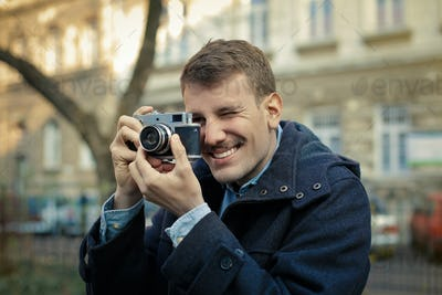 Man with a vintage camera