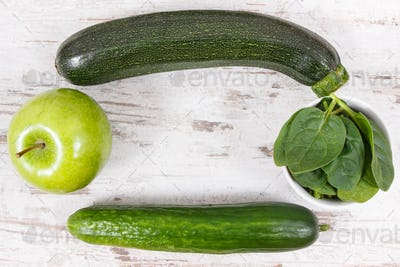 Green fruits and vegetables containing natural minerals, vitamins and fiber, copy space for text