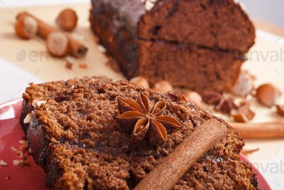 Gingerbread or dark cake with chocolate, cocoa and plum jam, delicious dessert
