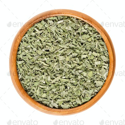 Dried sage in wooden bowl over white