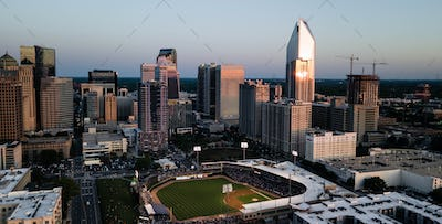 Ball Game at Sunset with Sunlight Reflecting of High Rise Architecture