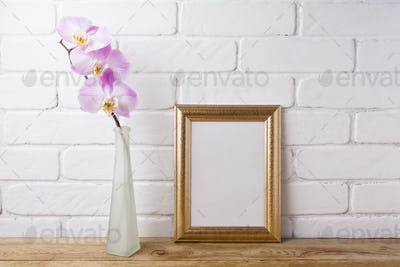 Gold decorated frame mockup with tender pink orchid