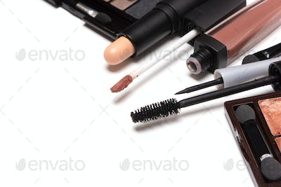Beauty products for natural day makeup on white with copy space