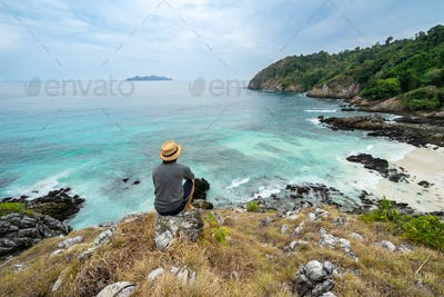 Young traveler looking beautiful seascape view