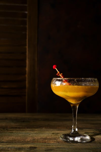 Frozen cocktail smoothie Margarita on a dark wooden background