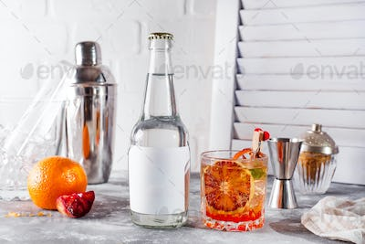 Fresh cocktail with orange and lemon on white wooden background ,