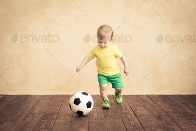 Child is pretending to be a soccer player