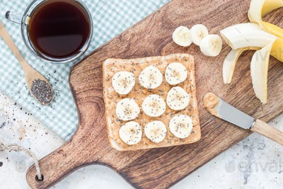 Healthy sandwich with crunchy peanut butter, banana and chia see