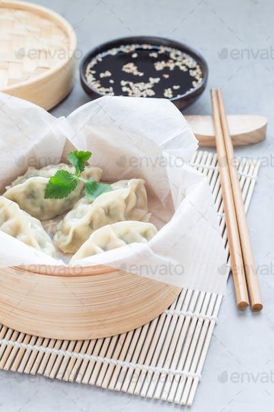 Steamed Korean dumplings Mandu with chicken meat and vegetables