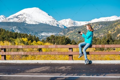 Tourist taking photo in Rocky Mountains at autumn, Colorado, USA.