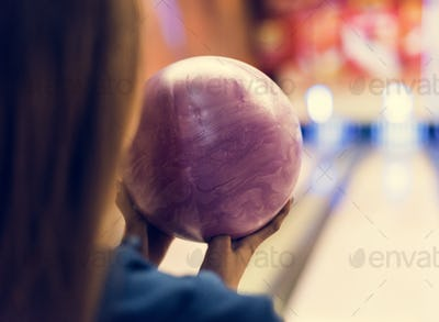Girl with pink bowling ball