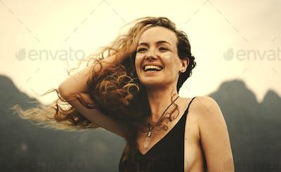 Blond woman enjoying the summer breeze