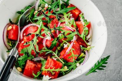 Watermelon with feta, arugula, onion, pine nuts and balsamic sauce.