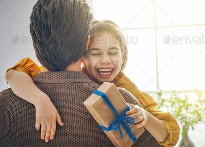 daughter congratulating dad