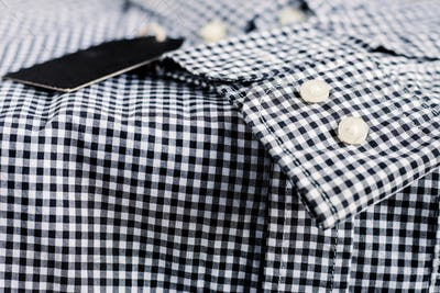 Button on sleeve of shirt