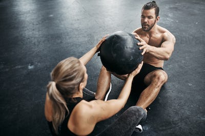 Fit people exercising with a medicine ball at the gym