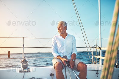 Mature man out for a sail on the open ocean