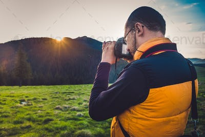 Nature photographer tourist in mountains