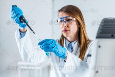 Laboratory technician using micro pipette