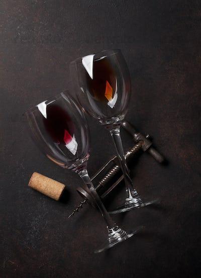 Wine glasses and vintage corkscrew