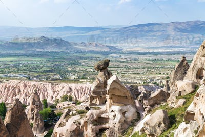 fairy chimney rocks in Uchisar town and valley