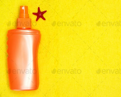 Sunscreen spray on terry towel with copy space