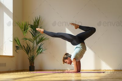 young fit woman doing stretching exercise