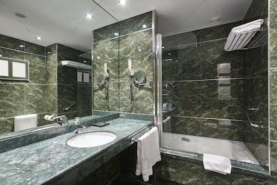 Luxury bathroom in green marble. Decoraton hotel home interior. Horizontal