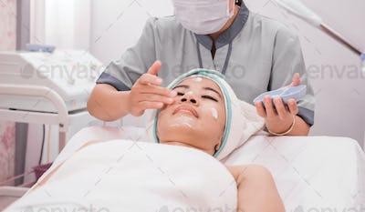 beautician perform beauty treatment