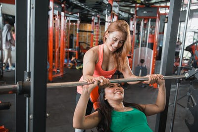 Woman working out with a smith machine