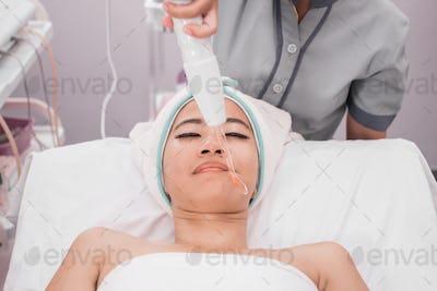 woman getting facial darsonval therapy