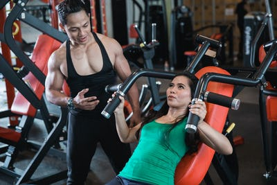 Young woman being encouraged by trainer