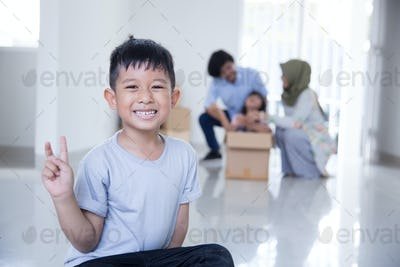 kid smiling to camera at his house