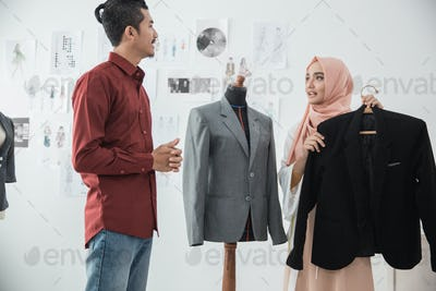 male and female fashion designer discussing