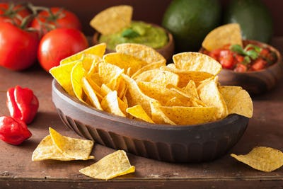 mexican guacamole and salsa dip with nachos tortilla chips