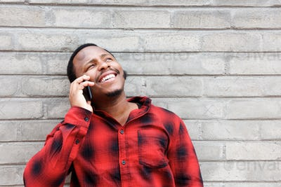 happy african american man talking on cellphone