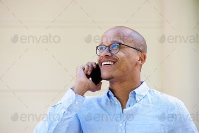 candid portrait of african businessman talking on cellphone