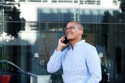 smiling businessman talking on cellphone