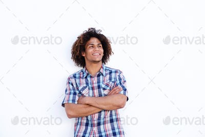 smiling young man standing against isolated white background