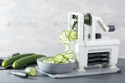 spiralizing cucumber vegetable with spiralizer