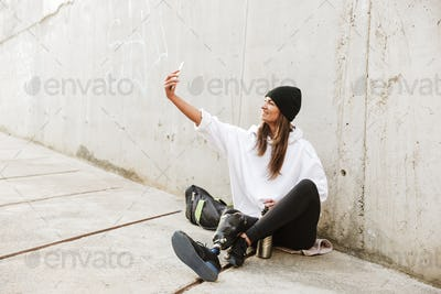 Photo of modern young handicapped woman in streetwear having bio