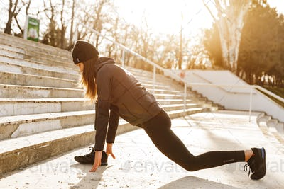 Image of disabled athletic girl in sportswear, exercising and st