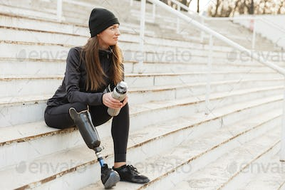 Portrait of attractive handicapped woman in black tracksuit with