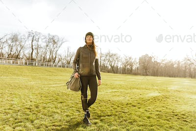 Picture of young handicapped girl with prosthetic leg in sportsw
