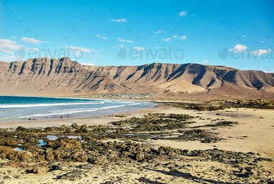 Landscape with volcanic hills and atlantic ocean in Lanzarote