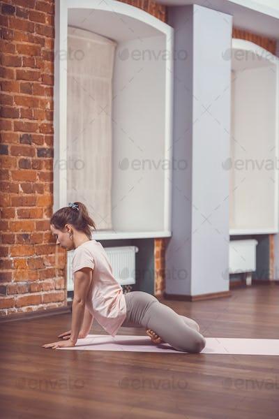 Training young girl in studio