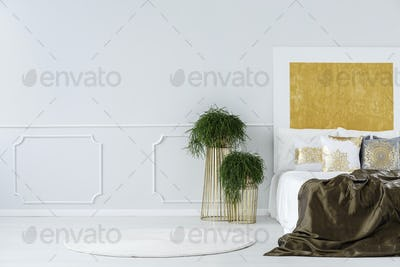 Abstract painting in minimalist bedroom