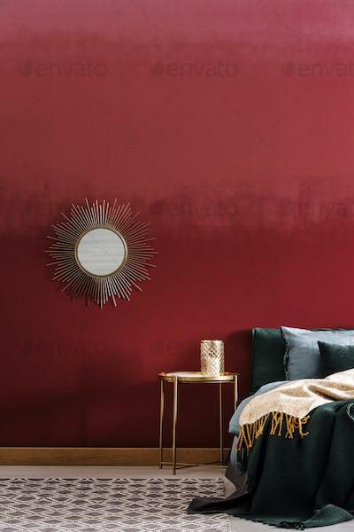 Decorative mirror on burgundy wall