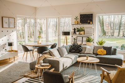 Wooden, round dining table in the corner of an open space living